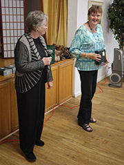 Charlotte Blum presents a silver life master award to Marcia Shulman