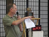 David Oakley points to a candidate at the 2009 unit board election. Eric Weiss trophy is in the background.