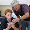 Rick Simpson helps a La Jolla High student learn bridge